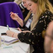 delegate taking notes
