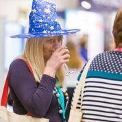 having a drink in wizard hat
